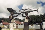 Two Islands Photos - Fishermen Balance Yellowfin Tuna Fish by Luis Marden