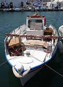 Aegean Photos - Fishing boat with octopus drying by Jane Rix