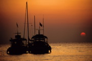 Sami Sarkis Prints - Fishing boats together at sunset Print by Sami Sarkis