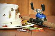 Angling Art - Fishing reel with hat and color lures by Sandra Cunningham