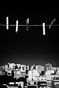 Clothes Pins Photos - Five Clothespegs Hanging On A Washing Line With Blue Sky Above City Skyline by Joe Fox