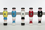 Player Posters - Five Foosball Figurines Wearing Different Uniforms Poster by Caspar Benson