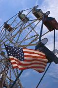 Enjoyment Photos - Flag In Front Of A Ferris Wheel by Todd Gipstein