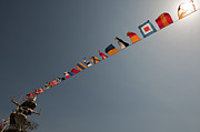 Symbolize Art - Flags Fly Over The Deck Of The Uss Iwo by Stocktrek Images