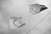 Turkish Photos - flags of turkey and TRNC turkish republic of northern cyprus flying in the sky above nicosia cyprus by Joe Fox