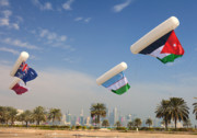 Doha Photo Framed Prints - Flags over Doha Framed Print by Paul Cowan