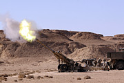 Artillery Photo Metal Prints - Flame And Smoke Emerge From The Muzzle Metal Print by Stocktrek Images