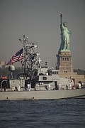 Liberty Island Posters - Fleet Week Vessels Pass By The Statue Poster by Stocktrek Images