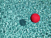 Water Photography Posters - Floating Red Ball In Blue Rippled Water Poster by Mark A Paulda