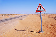 Out Of Context Posters - Flood warning sign on desert road Poster by Sami Sarkis