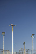 Fencing Framed Prints - Floodlights Above Baseball Backstops Framed Print by Ben Sandall