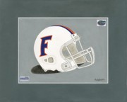 Florida Gators Framed Prints - Florida Gators Pro Combat Football Helmet Framed Print by Herb Strobino