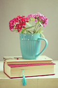 Israel Photos - Flowers In Blue Cup On Two Books by Copyright Anna Nemoy(Xaomena)