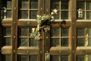 Cemeteries Photos - Flowers On The Wooden Door by Todd Gipstein