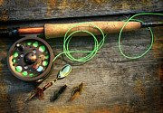 Fish Hook Posters - Fly fishing rod with polaroids pictures on wood Poster by Sandra Cunningham