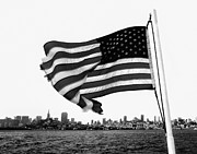 Skyline Photo Framed Prints - Flying Flag  Framed Print by Susan Stone