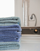 Washer Posters - Folded Towels on a Dryer Poster by Thom Gourley/Flatbread Images, LLC
