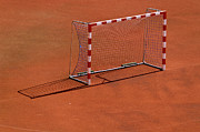 Net Photos - Football Net On Red Ground by Daniel Kulinski