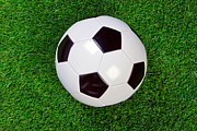 Sport Equipment Prints - Football on grass Print by Richard Thomas