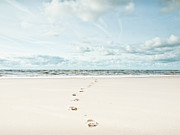 England Photos - Footprints Leading Into Sea by Dune Prints by Peter Holloway