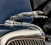 Antique Automobiles Photos - Ford Hood Ornaments  by Brian Mollenkopf