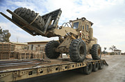 Machinery Photo Posters - Forklift Is Unloaded Off Of A Logistics Poster by Stocktrek Images