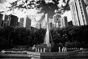 Surrounded Prints - Fountain Hong Kong Zoological And Botanical Gardens Surrounded By Tall Buildings  Print by Joe Fox