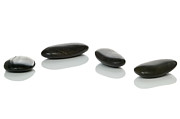 Unity Posters - Four black pebbles Poster by Richard Thomas