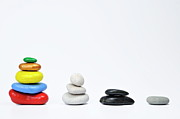 Sami Sarkis - Four growing stacks of multi-colored pebbles