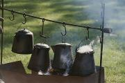 Oregon Trail Framed Prints - Four Metal Coffee Pots Steaming Over An Framed Print by Michael S. Lewis