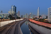 Tel Aviv Photos - Freeway Passing Downtown Buildings At Night by Noam Armonn