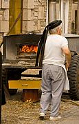 French Photo Originals - French Baker Prepares His Wood Buring Oven for Baking Bread by Mark Hendrickson