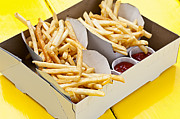 Snacks Posters - French fries in box Poster by Elena Elisseeva