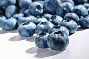 Fresh Fruit Posters - Fresh and Natural Blueberries Close Up on White Poster by Olivier Le Queinec