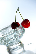 People On Ice Photos - Fresh Cherry With Ice In Bowl On White Background by Westend61