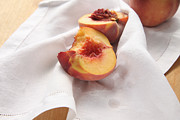 Peaches Photo Prints - Fresh Peaches on a White Napkin Print by Ruby Hummersmith