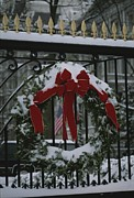 Snow Scenes Photo Prints - Fresh Snow Covers A Christmas Wreath Print by Stephen St. John