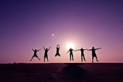 Togetherness Acrylic Prints - Friends Jumping Against Sunset Acrylic Print by Kazi Sudipto photography