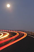 Yellow Line Photo Framed Prints - Full Moon Over a Curving Road Framed Print by Jetta Productions, Inc