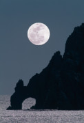 Sea Moon Full Moon Originals - Full moon rising over coastal cliff by David Nunuk