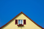 Red Roof Prints - Gable of beautiful house in front of blue sky Print by Matthias Hauser
