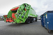 Compressed Metal Prints - Garbage Truck Parked In A Parking Lot Metal Print by Don Mason