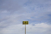 Gasoline Photos - Gas Station Road Sign by John Burcham