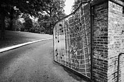 Elvis Posters - Gate And Driveway Of Graceland Elvis Presleys Mansion Home In Memphis Tennessee Usa Poster by Joe Fox