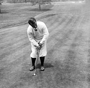 Putter Posters - Gene Sarazen playing golf Poster by International  Images