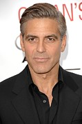 Clooney Photo Framed Prints - George Clooney At Arrivals For Oceans Framed Print by Everett