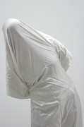 Drapery Photo Prints - Ghost - person covered with white cloth Print by Matthias Hauser