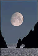 Gibbous Moon Prints - Gibbous Moon Rising Over A Coastal Cliff Print by David Nunuk
