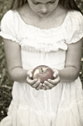 Kneeling Photo Prints - Girl And Apple Print by Joana Kruse