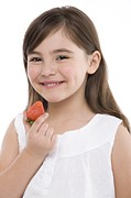 Brown Hair Posters - Girl Eating A Strawberry Poster by